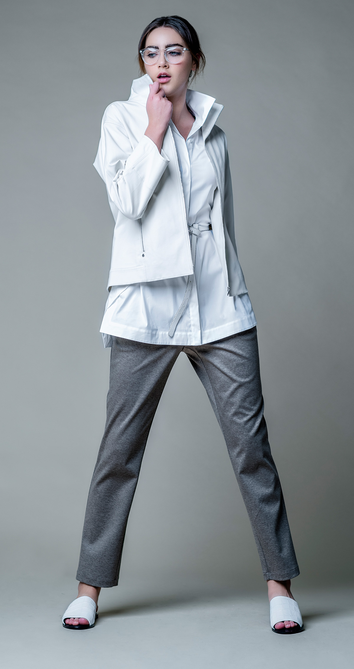 White shirt, white rain jacket, white leather belt, brown wool trousers and leather white sandals all by Lafayette 148 New York @ Brickell City Centre.